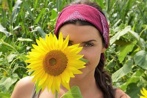 Jennifer Sharpe and a sunflower